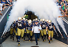 Sept. 6, 2014; Head football coach Brian Kelly charges out of the tunnel with his team before kickoff against  Michigan. (Photo by Barbara Johnston/ University of Notre Dame)