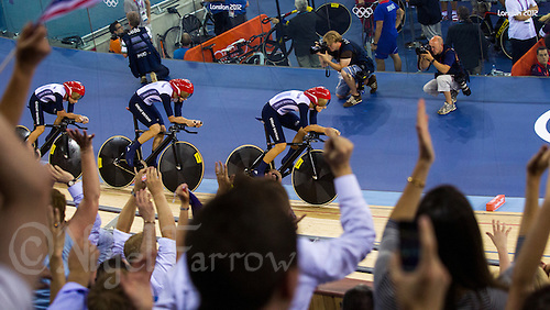 03 AUG 2012 - LONDON, GBR - Spectators cheer on the Great Britain (GBR) team of Dani King (right) and Joanna Rowsell (centre) and Laura Trott (left) during their women's team pursuit qualification round at the Olympic Park Velodrome in Stratford, London, Great Britain .(PHOTO (C) 2012 NIGEL FARROW)