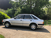 BNPS.co.uk (01202) 558833 <br /> Pic: ReemanDansie/BNPS<br /> <br /> The 'lost' Ford Escort car that Prince Charles gave to Princess Diana as an engagement present sold today for almost £60,000. <br /> <br /> The Ford Escort Mark III Ghia was Diana's daily runaround from May 1981 - two months before the Royal wedding - until August 1982.<br /> <br /> Diana regularly drove the 1980 silver motor to visit Charles during their engagement, especially at games of polo.<br /> <br /> Soon after taking ownership of the Escort, her elder sister, Lady Sarah Spencer, gave her a silver frog car mascot that Diana attached to the bonnet.