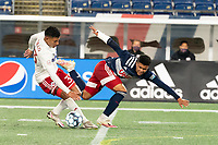 FOXBOROUGH, MA - OCTOBER 16: Edwin Cerrillo #33 of North Texas SC tackles Damian Rivera #72 of New England Revolution II during a game between North Texas SC and New England Revolution II at Gillette Stadium on October 16, 2020 in Foxborough, Massachusetts.