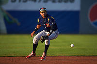 State College Spikes shortstop Leobaldo Pina (13) fields a ground ball during a game against the Auburn Doubledays on July 6, 2015 at Falcon Park in Auburn, New York.  State College defeated Auburn 9-7.  (Mike Janes/Four Seam Images)