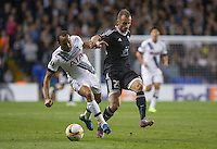 Andros Townsend of Tottenham Hotspur holds off Ansi Agolli of Qarabag FK during the UEFA Europa League match between Tottenham Hotspur and Qarabag FK at White Hart Lane, London, England on 17 September 2015. Photo by Andy Rowland.