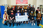 Students from Meán Scoil Nua an Leith-Triúigh, Castlegregory present a cheque for €300 to Recovery Haven at the school on Thursday. Seated l to r: Sally Ann Leahy, Naill Kilkillen, Dermot Crowley (Recovery Haven),  Aodán Mac Gearailt (Principal), Sarah Sheehy and Edel O'Connor.