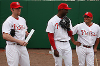 February 24, 2010:  Pitcher Brad Lidge, Pitcher Jose Contreras, and Catcher Carlos Ruiz (L-R) of the Philadelphia Phillies wait in line during photo day at Bright House Field in Clearwater, FL.  Photo By Mike Janes/Four Seam Images