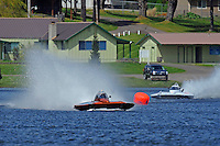 "Jim Mauldin, E-31and Jeff Bernard, E-1 ""MY-Way"" race out of the first turn."