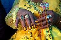 A dancer shows her painted nails and jewellery at the Carnaval de Oruro. During the fiesta many people sacrifice llamas and give offerings such as coca leaves and cigarettes to show their dedication to the Devil, a Virgin, Pachamama or Mother Earth. The Devil (or Uncle) is a mythical character that protects the miners of Oruro who work in dangerous conditions hundreds of metres below the ground. During the carnival, people dress in outrageous costumes and dance for days before arriving at the Church of Socavon, where they pay their respects to a virgin. Ironically, many of the dancers wear devil costumes.