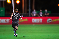 LAKE BUENA VISTA, FL - AUGUST 06: Chase Gasper #77 of Minnesota United FC dribbles the ball during a game between Orlando City SC and Minnesota United FC at ESPN Wide World of Sports on August 06, 2020 in Lake Buena Vista, Florida.