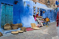 Chefchaouen, Morocco.  Street Scene: Straw Hats and Baskets for Sale.
