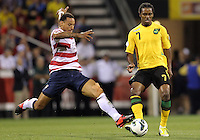 COLUMBUS, OHIO - SEPTEMBER 11, 2012:  Jermaine Jones (13) of the USA MNT flies into a tackle on Jason Morrison (7) of  Jamaica during a CONCACAF 2014 World Cup qualifying  match at Crew Stadium, in Columbus, Ohio on September 11. USA won 1-0.