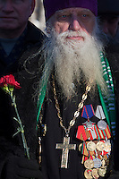 Moscow, Russia, 15/02/2011..A former soldier turned Orthodox priest at a meeting of Soviet veterans of the war in Afghanistan on the anniversary of the completion of the Soviet Union's withdrawal in 1989.