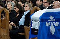 Chantal Renaud, wife of former Quebec premier Bernard Landry,  and his daughter Pascale listen to speeches during funeral services in Montreal on Tuesday, November 13, 2018. THE CANADIAN PRESS/Paul Chiasson