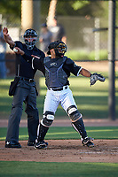 AZL White Sox catcher Ivan Gonzalez (62) throws to the pitcher in front of home plate umpire Chase Eubanks during an Arizona League game against the AZL Royals at Camelback Ranch on June 19, 2019 in Glendale, Arizona. AZL White Sox defeated AZL Royals 4-2. (Zachary Lucy/Four Seam Images)