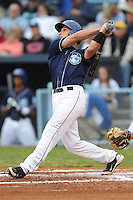 Asheville Tourists Dustin Garneau #15 swings at a pitch during a game against  the Lexington Legends at McCormick Field in Asheville,  North Carolina;  April 16, 2011. Lexington defeated Aheville 13-7.  Photo By Tony Farlow/Four Seam Images