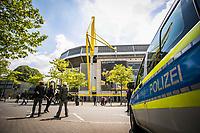 16th May 2020, Signal Iduna Park, Dortmund, Germany; Bundesliga football, Borussia Dortmund versus FC Schalke; Numerous journalists and media representatives gather in front of the Signal Iduna Park as well as police cars