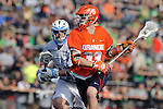 Baltimore, MD - March 17:  Defensemen Nikhon Schuler #36 Hopkins defends Midfielder Scott Loy #33 of the Syracuse Orangemen during the Syracuse v Johns Hopkins mens lacrosse game at  Homewood Field on March 17, 2012 in Baltimore, MD.(Ryan Lasek/Eclipse Sportswire)