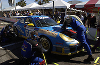 The Racer's Group Porsche makes it final stop for fuel on its way to overall victory...