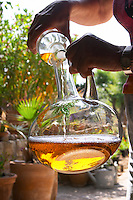 Marlène Soria Domaine Peyre Rose, St Pargoire. Gres de Montpellier. Languedoc. Pouring wine in a decanter. Wine aerating in a carafe. France. Europe. Bottle.