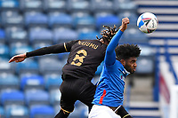 David Kasumu of Milton Keynes Dons wins a header from Ellis Harrison of Portsmouth during Portsmouth vs MK Dons, Sky Bet EFL League 1 Football at Fratton Park on 10th October 2020