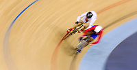 06 AUG 2012 - LONDON, GBR - Lisandra Guerra Rodriguez (CUB) (right) of Cuba leads Guo Shuang (CHN) of China during their Individual Sprint quarter final first race at the London 2012 Olympic Games track cycling at the Olympic Park Velodrome in Stratford, London, Great Britain (PHOTO (C) 2012 NIGEL FARROW)