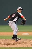 Pitcher Joe Burns (33) of the Hickory Crawdads in a game against the Greenville Drive on Friday, June 7, 2013, at Fluor Field at the West End in Greenville, South Carolina. Greenville won the resumption of this May 22 suspended game, 17-8. (Tom Priddy/Four Seam Images)