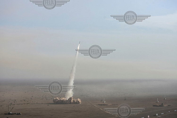 A short-range missile (Fateh) is test-launched during war games 120 kms south of Tehran.