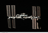 Surrounded by the blackness of space, the International Space Station is featured in this image photographed by an STS-130 crew member on space shuttle Endeavour after the station and shuttle began their post-undocking relative separation. Undocking of the two spacecraft occurred at 7:54 p.m. (EST) on Friday, February 19, 2010. A partial shadow of Endeavour is visible on the solar array wing panels at lower right..Credit: NASA via CNP
