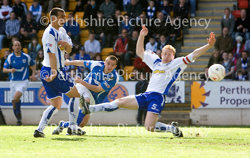 St Johnstone v Morton....02.05.09.Steven Milne scores to make it 3-1.Picture by Graeme Hart..Copyright Perthshire Picture Agency.Tel: 01738 623350  Mobile: 07990 594431