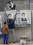 BAGHDAD, IRAQ: Workmen put up elections posters in the lead up to the March 7th Parliamentary elections in Iraq...Photo by Ceerwan Aziz/Metrography.