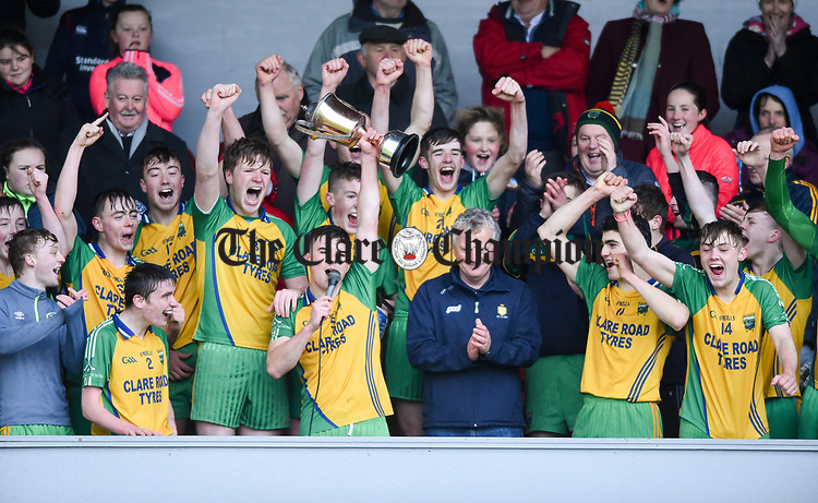 Inagh-Kilnamona players celebrate with the cup following their Minor A county final win over Kilmaley at Cusack Park. Photograph by John Kelly.