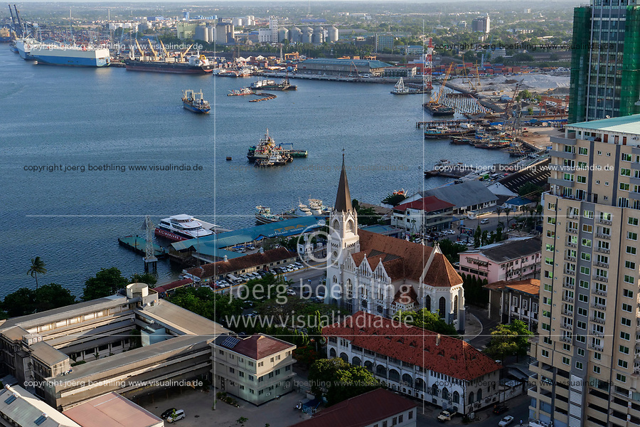 TANZANIA Daressalaam, bay and seaport, in front catholic St. Joseph cathedral, built during german colonial time, and passenger ferry terminal