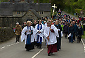 14/05/15<br /> <br /> The clergy are followed by crowds as they make their way between all the villages' six wells.<br /> <br /> To mark ascension day this year's well dressings are unveiled and blessed by the local clergy in the Derbyshire village of Tissington in the Peak District National Park.<br /> <br /> Before today's blessings, wooden boards coated in clay are decorated with tens of thousands of petals, leaves and pieces of foliage to create the giant intricate mosaics. The boards,  take teams of many villagers three days to make. <br /> <br /> The village has been decorating its six wells every year for more than six hundred years. The tradition is believed to be a celebration of the wells never running dry, giving life and  sustaining the village during times of plague. After a church service today (Thursday)  clergy from six parish will bless each of the well.  <br /> <br /> Following in Tissington's footsteps many other villages in the Derbyshire area also have their own well dressing traditions.<br /> <br /> <br /> All Rights Reserved: F Stop Press Ltd. +44(0)1335 418629   www.fstoppress.com.