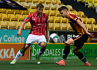 Lincoln City's James Jones vies for possession with Bradford City's Connor Wood<br /> <br /> Photographer Chris Vaughan/CameraSport<br /> <br /> Carabao Cup Second Round Northern Section - Bradford City v Lincoln City - Tuesday 15th September 2020 - Valley Parade - Bradford<br />  <br /> World Copyright © 2020 CameraSport. All rights reserved. 43 Linden Ave. Countesthorpe. Leicester. England. LE8 5PG - Tel: +44 (0) 116 277 4147 - admin@camerasport.com - www.camerasport.com
