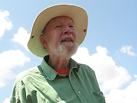 Pete Seeger portraits and walks down street in Chelsea with his banjo in 2009