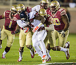 The Florida State defense wraps up tailback Taquan Mizell when Florida State defeated Virginia 34-20 in an NCAA football game in Tallahassee, FL November 8, 2014