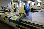 Machines cut the fabric, Santini Factory, Lallio, Italy. 30th September 2015.<br /> Picture: Eoin Clarke | Newsfile