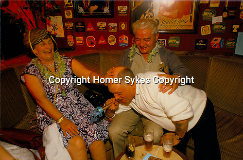 Package holiday 'Young at Heart', 1980s. Magaluf, Majorca, Spain.  Oaps drinking having a good night out.
