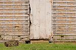Old corn crib door and push lawn mower on Stolfus Amish Farm.