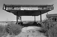 Closed an abandoned Standard-Chevron gas station at the Glenrio exit of Interstate 40 in Texas.