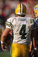 SAN FRANCISCO, CA: Quarterback Brett Favre of the Green Bay Packers stands on the sidelines during the NFC playoff game against the San Francisco 49ers at Candlestick Park in San Francisco, California on January 6, 1996. (Photo by Brad Mangin)