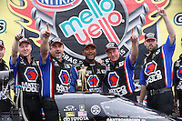 Mar. 17, 2013; Gainesville, FL, USA; NHRA top fuel dragster driver Antron Brown celebrates with crew after winning the Gatornationals at Auto-Plus Raceway at Gainesville. Mandatory Credit: Mark J. Rebilas-