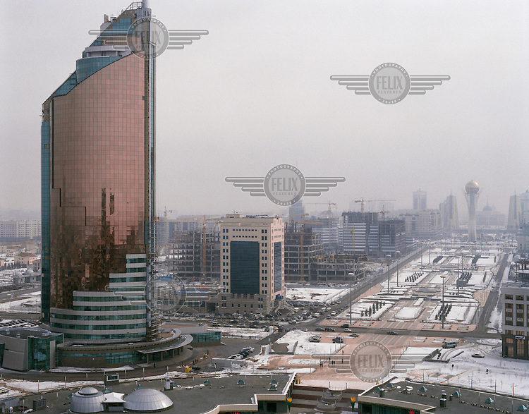 View from the headquarters of KazMunayGas, the state oil and gas company, over the new capital city, with the Ministry of Transportation and Telecommunications on the left and Bayterek tower on the right.
