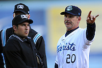 Asheville Tourists manager Joe Mikulik goes over the ground rules with home plate umpire Ryan Bealo before a game between the Delmarva Shorebirds and the Asheville Tourists April 6, 2012. The Shorebirds won the game 7-2  (Tony Farlow/Four Seam Images)..