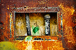 Faded graffiti on old rusted steel wall access panel. Abandoned military gunnery bunkers at Fort Worden State Park, Port Townsend, WA.  Cubist, abstract, representaional.