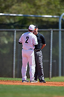 Dartmouth Big Green head coach Bob Whalen (2) argues a call with the first base umpire during a game against the Villanova Wildcats on March 3, 2018 at North Charlotte Regional Park in Port Charlotte, Florida.  Dartmouth defeated Villanova 12-7.  (Mike Janes/Four Seam Images)