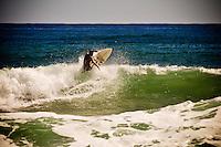 Surfers at Kealia Beach, Kauai, Hawaii