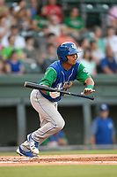 Third baseman Carlos Diaz (14) of the Lexington Legends squares around to bunt during a game against the Greenville Drive on Saturday, September 1, 2018, at Fluor Field at the West End in Greenville, South Carolina. Greenville won, 9-6. (Tom Priddy/Four Seam Images)