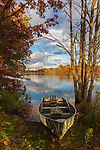 An old boat resting on the autumn shore of a wilderness lake in northern Wisconsin.