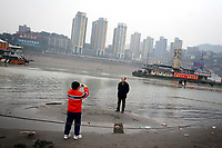 CHINA. Sichuan Province. Chongqing. Tourists next to The Yangtze River which is at its lowest level in 150 years as a result of a country-wide drought. Chongqing is a city of over 3,000,000 people, famed for being the capital of China between 1938 and 1946 during World War II. It is situated on the banks of the Yangtze river, China's longest river and the third longest in the world. Originating in Tibet, the river flows for 3,964 miles (6,380km) through central China into the East China Sea at Shanghai.  2008