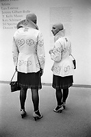 Germany. Bavaria state. Munich. Museum. Pinakothek der Moderne. Eva & Adele are a couple of german artists who live and create Above Gender Boundaries. They dress identically to each other in makeup and bald heads. Although as a man and a women and in a relationship for 22 years, the two could get married, it was important for them to be able to marry as two women. However, Eva (who has a deep voice and broad shoulders) argued to court that although her body was a man, her soul was not. After reading numerous psychiatric and psychological reports, the judge agreed. Eva's birth certificate was then reissued with her sex as female. Their guiding principle is: Wherever they are is museum. they want to impose on the world their vision of Futuring. Eva & Adele function in public space as an art work. The artists treat their own bodies as living sculpture 6.07.07 © 2007 Didier Ruef
