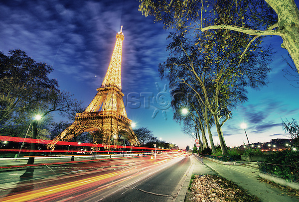 PARIS - DEC 1: Eiffel Tower shows its wonderful lights at sunset with car light trails, December 1, 2012 in Paris. The Tower is lit by more than 350 lamps mounted within the structure of the tower itself